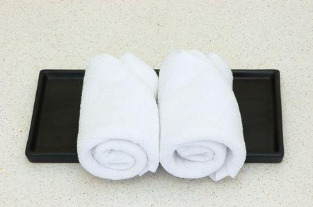 white towel on black tray photo