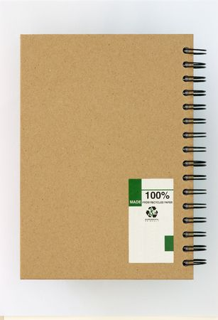 Recycle paper notebook back cover on white background photo