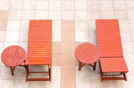 empty poolside deckchairs with beautiful blue swimming pool from top view photo