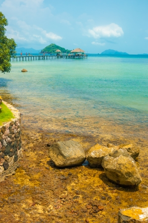 trad: brown rock seashore with turquoise color sea in Maak island in Trad province, Thailand