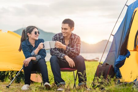 Young Asian couples are having fun together in the evening nature camping trip