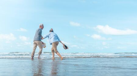 Mature mother and son dancing on the beach