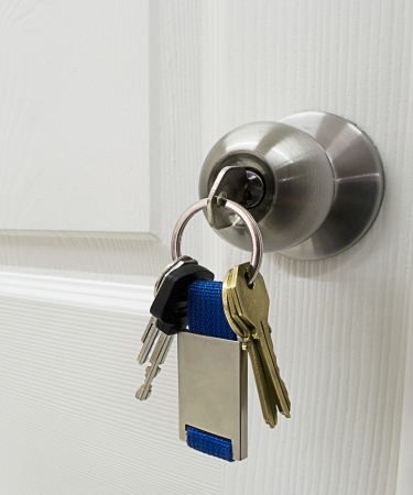 Keys in a latch opening or closing a door Imagens