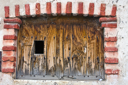 Old wooden window with brick frame