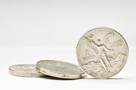 silver coins: Silver coins with difuse background