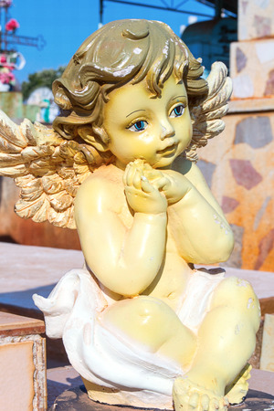 cherub: Vertical photo in color about a cherub in graveyard Stock Photo