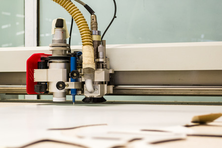 computerized: Horizontal photo in color of an electric computerized leather cutting machine