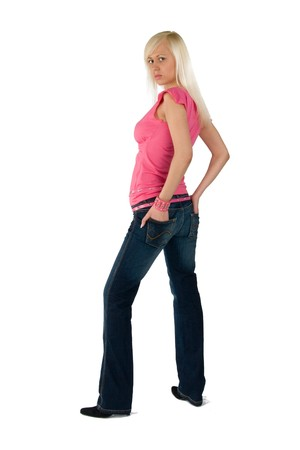blonde in a pink blouse and blue jeans Stock Photo
