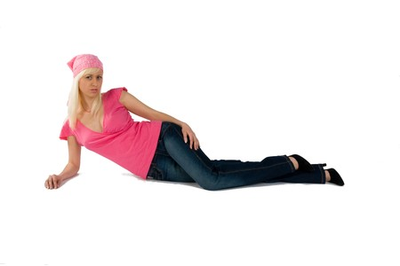 blonde in a pink blouse and blue jeans laying Stock Photo
