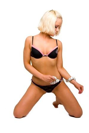 blond girl in underwear with handcuffs