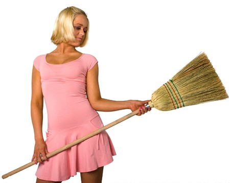 blonde in dress and broom Stock Photo