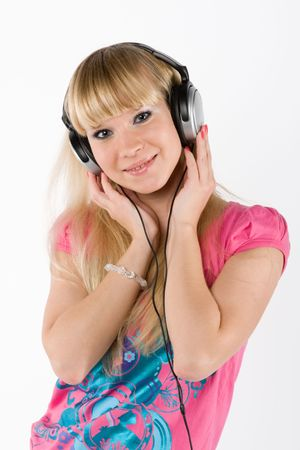 blonde girl with headphones on white photo