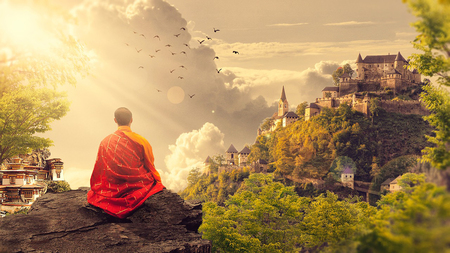 Buddhist monk who looks at the horizon. fantastic scenery Фото со стока
