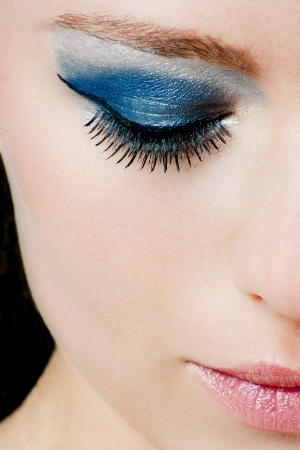 Half face of a beautiful woman with blue makeup and pink lipstick Stock Photo - 19687098