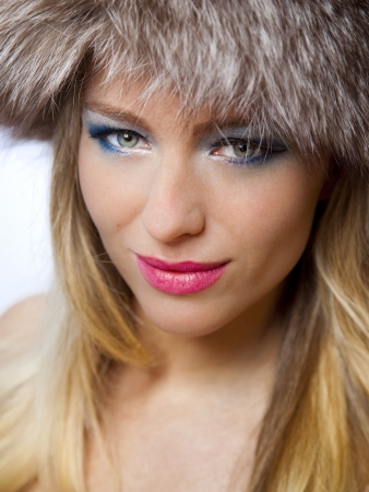 russian hat: Beautiful young woman with russian hat wearing blue makeup and pink lipstick