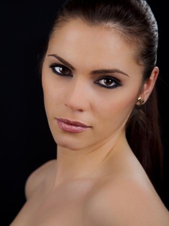 Portrait of a beautiful young romanian woman with pink lipstick and smokey eyes photo