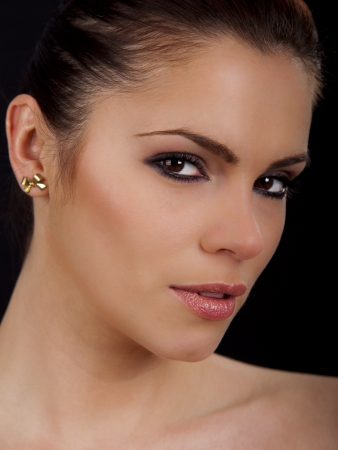Portrait of a beautiful young romanian woman with pink lipstick and smokey eyes
