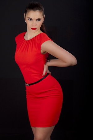 Beautiful young romanian woman posing in red dress with smokey eyes and red lipstick Stock Photo - 19722902