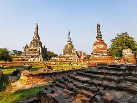 Ancient city of Ayutthaya with various temples and beautiful blue sky Ayutthaya, Thailand - 2-20-2020