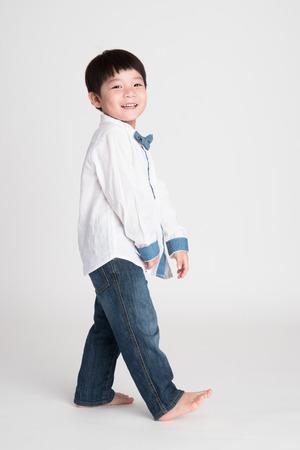little asian boy on gray background