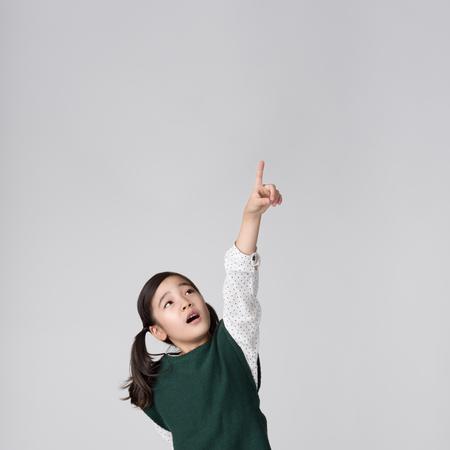 romp: Asian girls studio shot Stock Photo