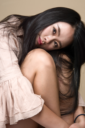 Studio shot of young asian woman portrait - isolated