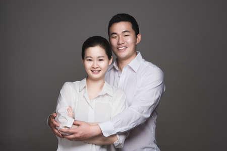 30s: Studio portrait of 30s happy asian couple - isolated Stock Photo