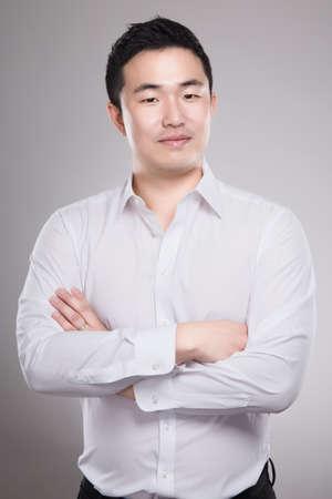 30s: 30s asian business man studio portrait - isolated