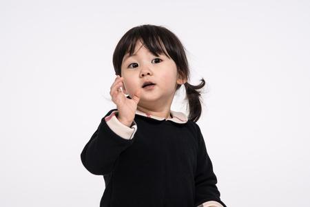 inexpressive: Studio portrait shot of 3-year-old Asian baby - isolated Stock Photo
