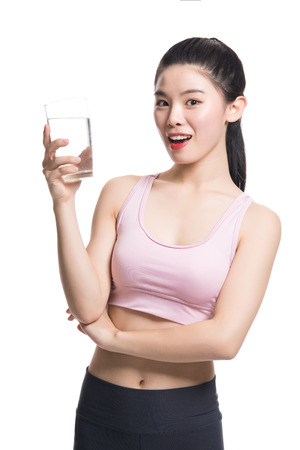 Studio portrait of Asian Yoga teacher drinking water