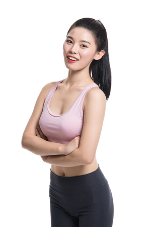 A studio portrait of a confident Asian Yoga teacher