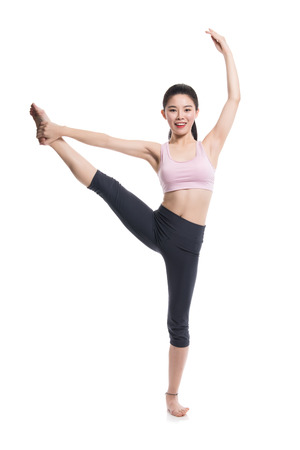 20 years old: A studio portrait of a twenties Asian woman showing flexible and amazing behavior