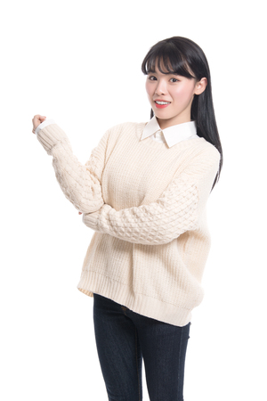 Studio portrait of happy twenties Asian woman