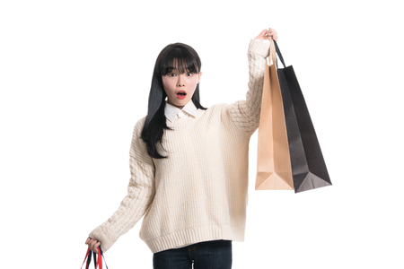 20 year old: Studio portrait of twenties Asian woman happily shopping