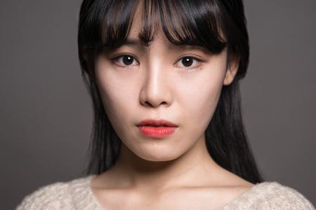Studio Female of 20 Sad Asian Women Stock Photo