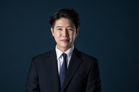 chuckle: Portrait of a happy Asian business man Stock Photo