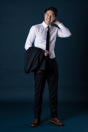 East Asian Businessman shooting studio portrait