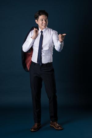 chuckle: East Asian Businessman shooting studio portrait