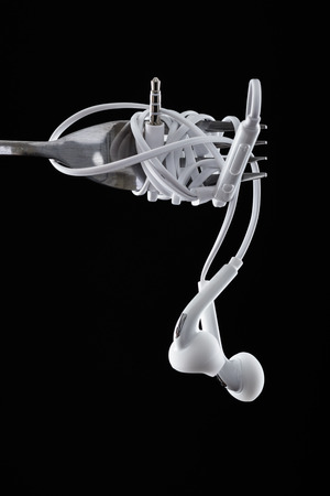 Earphone on black background. Concept of Music Stock Photo