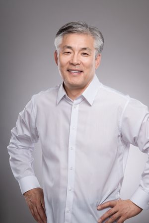 Middle aged asian business man studio portrait photo - isolated Stock Photo - 84222885