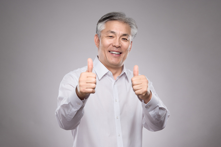 Happy Asian middle-aged couple studio portrait Stock Photo