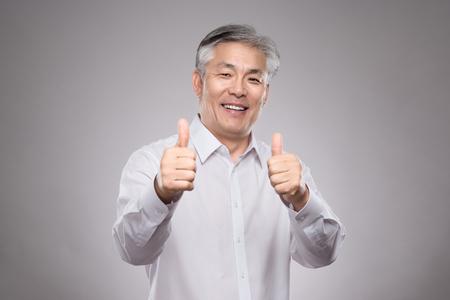 Happy Asian middle-aged couple studio portrait Stock fotó