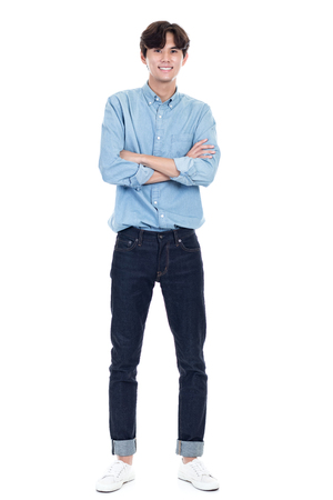 Studio full body portrait of a young asian man 스톡 콘텐츠