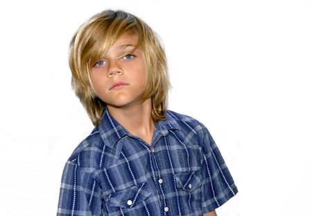 cute young boy in blue shirt isolated on white background.