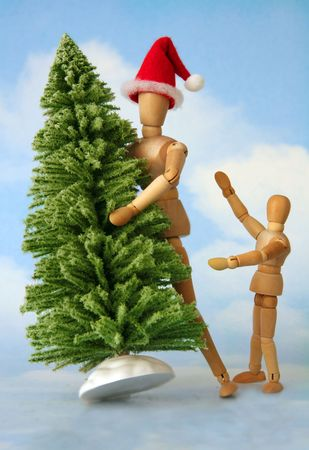 Adult and child figurines finding the perfect christmas tree.