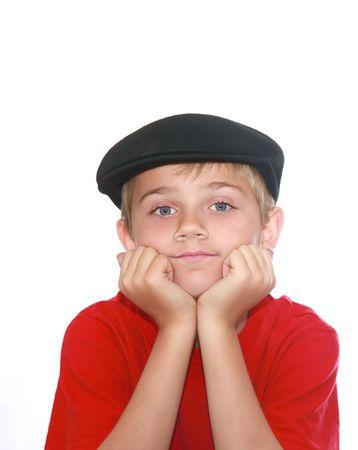 Cute garçon avec le menton dans la main, regarder avec nostalgie dans l'appareil photo, isolé sur blanc. Banque d'images - 3577781