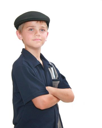 newsboy cap: Young preteen boy with arms crossed, isolated on white. Stock Photo