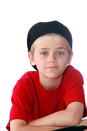 Cute blue eyed preteen boy with red shirt and black cap isolated on white. Stock Photo - 3593984
