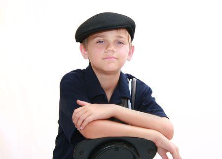 Portrait du beau jeune garçon en bleu avec capuchon newsboy, isolé sur blanc. Banque d'images - 3593980