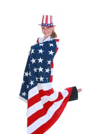 Jolie jeune femme célèbre quatrième de Juillet avec chapeau et le drapeau. Banque d'images - 3593975
